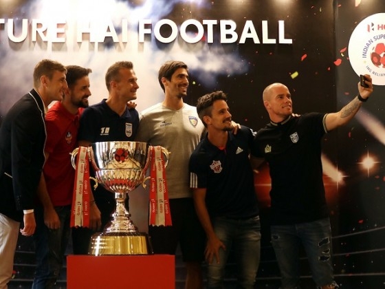 John Johnson of Bengaluru FC, Bruno Filipe Tavares Pinheiro of FC Goa, Lucian Goian of Mumbai City FC, Henrique Sereno of Chennaiyin FC, Marcelo Leite Pereira of FC Pune City and Iain Hume of Kerala Blasters FC pose for picture with the ISL Trophy