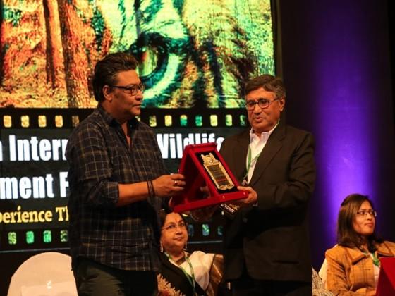 Indranil Sen hands over a Green Warrior award