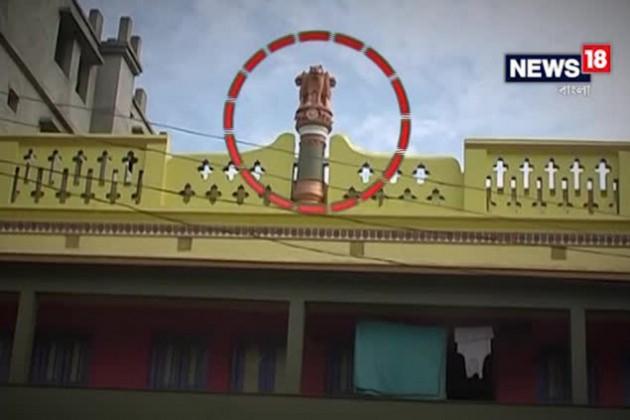 নিয়মের গেরোয় বাড়ির ছাদ থেকে সরল অশোকস্তম্ভ