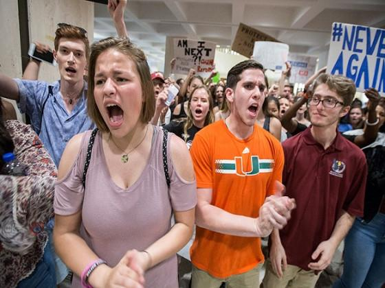 Students chant protest slogans outside the Florida House of Representatives chamber inside the Florida Capitol in Tallahassee. (Image: AP)